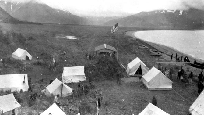 This June 9, 1912 photo courtesy of the U.S. Geological Survey shows a refugee camp established by Captain Perry of the U.S. Revenue Service cutter Manning after the Novarupta-Katmai volcano eruption in Alaska. A century after one of the world's largest volcanic eruptions, ash and pumice are still plentiful in Alaska's Valley of Ten Thousand Smokes. The three-day explosion that began June 6, 1912, spewed ash 100,000 feet above the state's Katmai region, covering the valley to depths up to 700 feet. (AP Photo/U.S. Geological Survey, G.C. Martin)