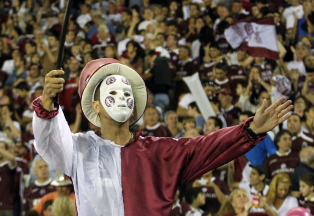A fan of Argentina's Lanus waits for the start of the final Copa Sudamericana soccer match against Brazil's Ponte Preta in Buenos Aires
