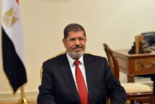 Hundreds of Egyptians have been making their way to the presidential palace in Cairo to air their grievances and demand solutions directly from newly-elected President Mohamed Morsi, seen here on July 2