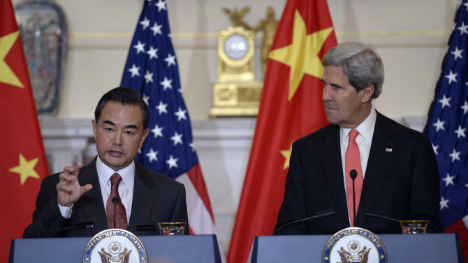 Secretary of State John Kerry, right, listens as Chinese Foreign Minster Wang Yi, left, speaks before their bilateral meeting at the State Department in Washington, Thursday, Sept. 19, 2013. Syria and North Korea as well as other issues were to be discussed. (AP Photo/Susan Walsh)