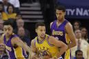 Golden State Warriors guard Stephen Curry (30) is defended by Los Angeles Lakers guards D'Angelo Russell, left, and Jordan Clarkson during the first half of an NBA basketball game in Oakland, Calif., Tuesday, Nov. 24, 2015. (AP Photo/Jeff Chiu)