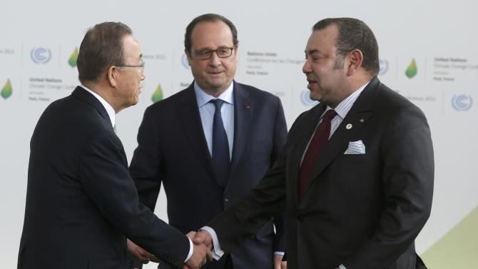 United Nations Secretary General Ki-moon and French President Hollande welcome Morocco's King Mohammed VI as he arrives for the opening day of the World Climate Change Conference 2015 (COP21) at Le Bourget, near Paris