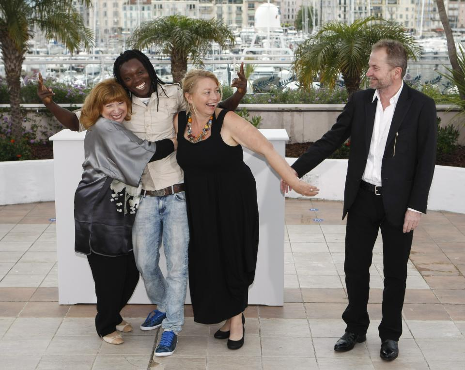 From left actors, Inge Maux, Peter Kazungu, Margarethe Tiesl and director Ulrich Seidl pose during a photo call for Paradise: Love at the 65th international film festival, in Cannes, southern France, Friday, May 18, 2012. (AP Photo/Lionel Cironneau)
