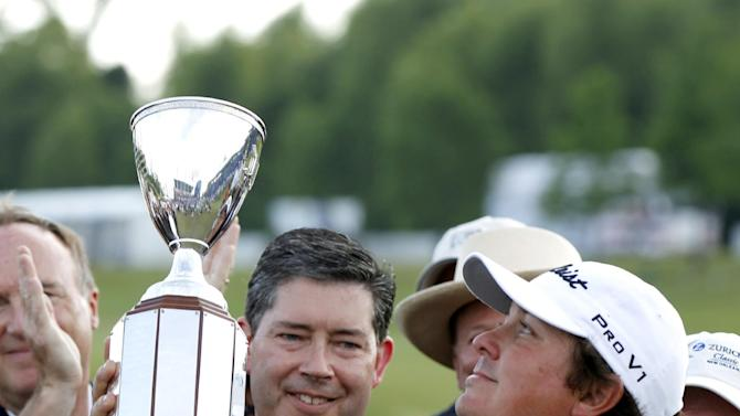 Jason Dufner holds the trophy after defeating Ernie Els in a sudden-death playoff to win the Zurich Classic golf tournament at TPC Louisiana in Avondale, La., Sunday, April 29, 2012. (AP Photo/Gerald Herbert)