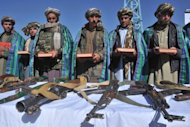 Former Taliban fighters display their weapons after they joined Afghan government forces during a ceremony in Herat on October 22. Afghanistan's presidential election will be held on April 5, 2014, months ahead of the final withdrawal of NATO combat troops from the insurgency-plagued nation, a poll official said on Tuesday