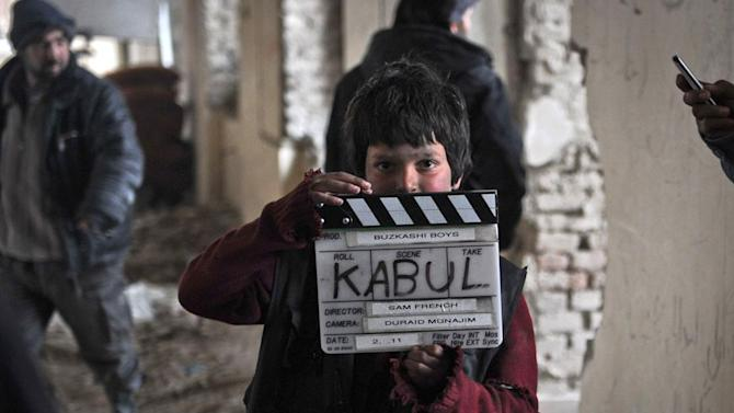 """An undated production still photograph from the Oscar-nominated film, """"Buzkashi Boys,"""" which was filmed in Kabul, Afghanistan, shows actor Jawanmard Paiz on the set of the film. Jawanmard Paiz was plucked from the dingy streets of the Afghan capital to be one of the main stars of """"Buzkashi Boys,"""" a coming-of-age movie filmed entirely in a war zone and nominated in the Best Live Action Short Film category. (AP Photo/David Gill, Afghan Film Project)"""
