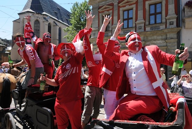 Danish Fans Sing On The Back Of A Horse Drawn Carriage In Lviv's Main Square Prior To The Group B Clash Germany Vs AFP/Getty Images