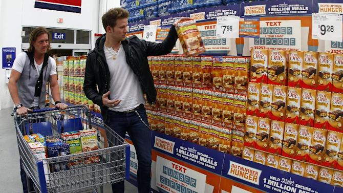 IMAGE DISTRIBUTED FOR GENERAL MILLS - Florida Georgia Line's Tyler Hubbard, left, and Brian Kelley shop for General Mills products at Sam's Club in support of Outnumber Hunger on Tuesday, March 19, 2013, in Nashville, Tenn.  (Photo by Wade Payne/Invision for General Mills/AP Images)