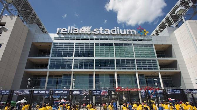 FILE - This Aug. 30, 2012 photo shows the exterior of Reliant Stadium before an NFL preseason football game between the Houston Texans and the Minnesota Vikings, in Houston. A fan was taken to a Houston hospital after falling from an escalator at Reliant Stadium. A statement issued by officials of Reliant Park, where the stadium is situated, says the fan fell from the escalator Thursday night, Aug. 30, 2012, while attending a preseason game between the Houston Texans and Minnesota Vikings.(AP Photo/Dave Einsel, File)
