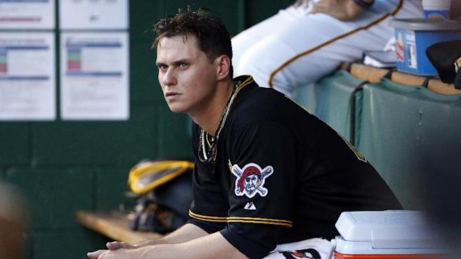 Pittsburgh Pirates starting pitcher Jeff Locke sits in the dugout during the second inning of a baseball game against the Miami Marlins in Pittsburgh, Tuesday, May 26, 2015. The Pirates won 5-1, with Locke getting his third win. (AP Photo/Gene J. Puskar)