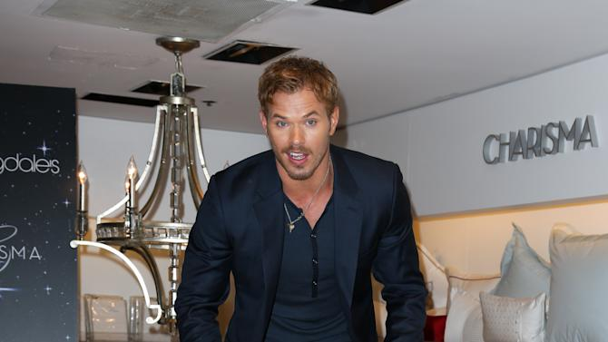 This image released by Starpix shows actor Kellan Lutz jumping on a bed during a Fashion's Night Out event at Bloomingdale's, Thursday, Sept. 6, 2012 kicking off Fashion Week in New York. (AP Photo/Starpix, Andrew Toth)