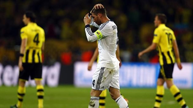 Real Madrid's Sergio Ramos (R) and Borussia Dortmund's Mario Goetze fight for a high ball during their Champions League semi-final first leg match in Dortmund April 24, 2013. (Reuters)