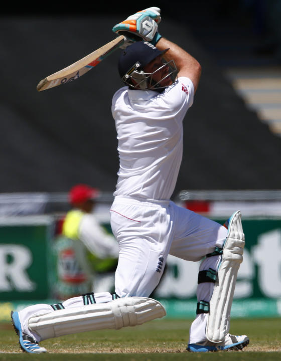 England's Bell hits a four runs during the third day of the second Ashes test cricket match against Australia in Adelaide
