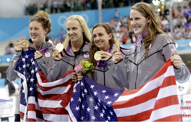 United States' 4 x 100-meter medley relay team from left, Allison Schmitt, Dana Vollmer, Rebecca Soni and Missy Franklin pose with their gold medals at the Aquatics Centre in the Olympic Park during t