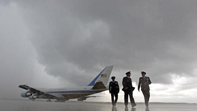 Air Force One, with President Barack Obama aboard, taxis on the runway under a heavy rain before departing at Andrews Air Force Base, Md., Wednesday, Sept. 5,  2012, en route to Charlotte, N.C. for the Democratic National Convention. ( AP Photo/Jose Luis Magana)