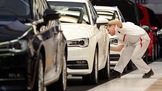 "FILE - The March 11, 2013 file photo shows an employee of German car producer Audi checking a car in the finish area on the assembly line of the Audi production site in Ingolstadt, southern Germany. Germany's central bank said Monday, July 22, 2013 recent data indicate the country's economy, Europe's biggest, ""expanded strongly"" in the second quarter following a weak start to the year. The Bundesbank said in its monthly report that it believes industry and construction made significant contributions to growth in the April-June period. The economy grew by 0.1 percent in the first quarter, weighed down by a long winter that hit sectors such as construction and the financial crisis among the 17 European Union countries that use the euro. (AP Photo/Matthias Schrader)"