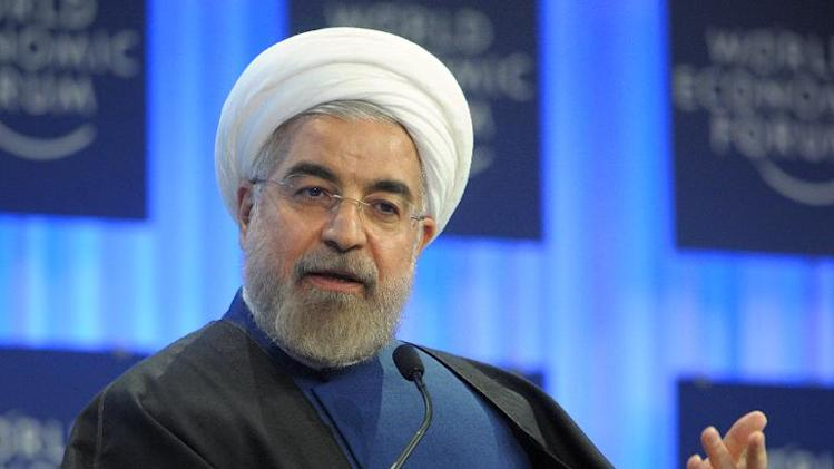 Iran's president Hassan Rouhani addresses the World Economic Forum in Davos on January 23, 2014