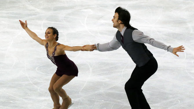 Meagan Duhamel, left, and Eric Radford, right, of Canada, perform in the pairs free skating at the ISU Figure Skating Eric Bompard Trophy, at Bercy arena in Paris, Saturday, Nov. 17, 2012. (AP Photo/Michel Euler)
