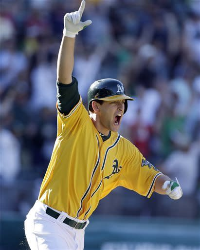 Freiman's 18th-inning single lifts A's over Yanks