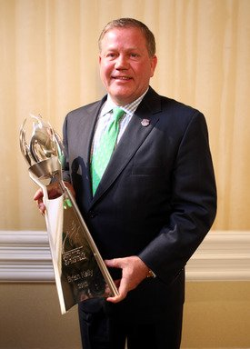 University of Notre Dame head coach Brian Kelly received last year's Liberty Mutual Coach of the Year Award at the FBS level, receiving a $70,000 in donations for charity and scholarship