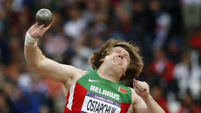 FILE -  In this Monday, Aug. 6, 2012 file photo, Belarus' Nadzeya Ostapchuk takes a throw in the women's shot put final during the athletics in the Olympic Stadium at the 2012 Summer Olympics, London. Ostapchuk became the first athlete to be stripped of a medal at the London Olympics after her gold was withdrawn for doping. Valerie Adams of New Zealand will now take gold and Evgeniia Kolodko of Russia will get silver. Fourth-place finisher Gong Lijiao of China moves up to bronze. The International Olympic Committee said Monday Aug. 13, 2012 that Ostapchuk tested positive for the steroid metenolone. She won the shot put exactly a week earlier. The IOC says she was tested the day before her competition and again following the event. Both samples were positive. (AP Photo/Matt Dunham)