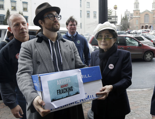 "<p>               Sean Lennon and Yoko Ono help deliver boxes of comments to the New York State Department of Environmental Conservation on its proposed natural gas drilling regulations on Friday, Jan. 11, 2013, in Albany, N.Y. Environmental, health and community groups opposed to shale gas drilling and hydraulic fracturing, or ""fracking,"" say they collected more than 200,000 comments during an intense 30-day effort featuring online coaching and comment-writing workshops at churches, community centers, food co-ops, coffee shops and holiday house parties from New York City to Buffalo. (AP Photo/Mike Groll)"