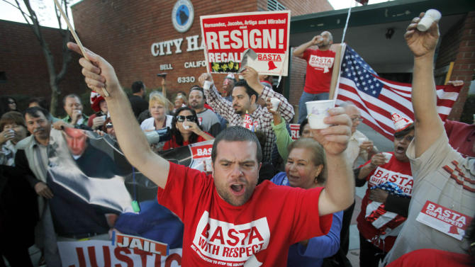 "FILE - This Sept. 21, 2010 file photo shows Jesus Casas, a member of the Bell Association to Stop The Abuse, or BASTA, which also means ""enough"" in Spanish, joining other residents of the city of Bell, Calif., celebrating the arrest of current and former city officials on corruption charges, outside City Hall. an official of the city of Bell, Calif. Jury selection begins Tuesday, Jan. 15, in the trial of former officials of the scandal ridden city of Bell in a massive corruption case that nearly bankrupted the working-class Los Angeles suburb.  (AP Photo/Reed Saxon, File)"