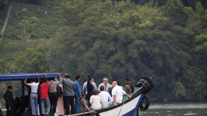 A ferry transports visitors, including relatives of death row prisoners Rodrigo Gularte and Sergei Atlaoui, to the prison island of Nusakambangan