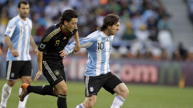 FILE - The July 3, 2010 file photo shows Argentina's Lionel Messi, right, and Germany's Mesut Ozil during the World Cup quarterfinal soccer match between Argentina and Germany at the Green Point stadium in Cape Town, South Africa. On Sunday, July 13, 2014, Germany and Argentina will face each other again in the final of the 2014 soccer World Cup. (AP Photo/Matt Dunham, file)