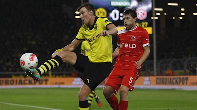 Fortuna Duesseldorf's Juanan challenges Borussia Dortmund's Kevin Groisskreutz (L) during the German first division Bundesliga soccer match in Dortmund