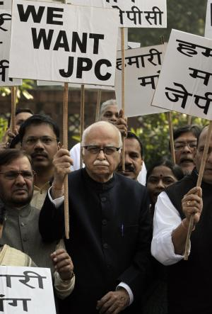 India's opposition Bharatiya Janata Party leader Lal Krishna Advani, center, holds a placard demanding a Joint Parliamentary Committee (JPC) probe into the telecom scandal as he stands with others during a protest outside the Indian parliament in New Delhi, India, Monday, Dec. 13, 2010. The four-week winter session of India's parliament ended Monday without conducting any legislative business, paralyzed throughout by an angry opposition demanding a probe into a telecommunications scandal that cost the country billions. (AP Photo/Manish Swarup)