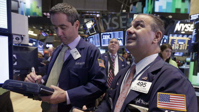 Trader Daniel Trimble, left, and Joseph Lucchese, right, work on the floor of the New York Stock Exchange Wednesday, Nov. 13, 2013. Stocks are getting off to a weak start on Wall Street, following overseas markets lower. (AP Photo/Richard Drew)