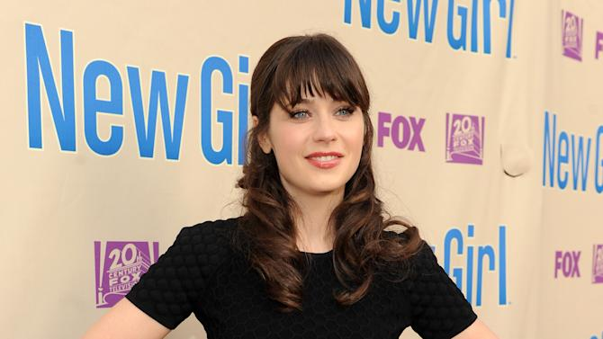 """Actor Zooey Deschanel arrives at FOX's """"New Girl"""" screening and Q&A at the Academy of Television Arts & Sciences' Leonard H. Goldenson Theater on Tuesday, April 30, 2013 in North Hollywood, California. (Photo by Frank Micelotta/Invision for FOX/AP Images)"""