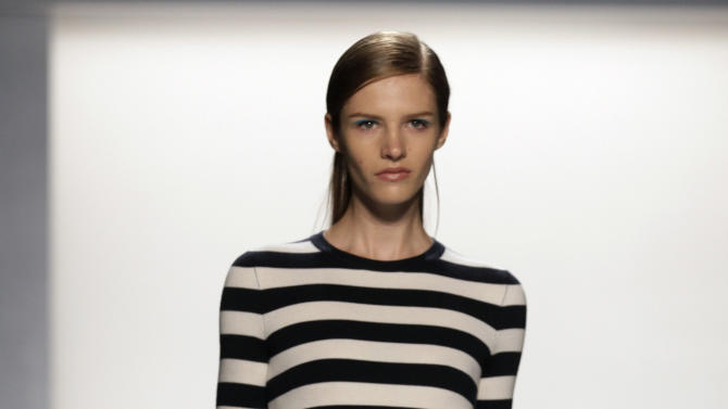 The Michael Kors Spring 2013 collection is modeled during Fashion Week in New York,  Wednesday, Sept. 12, 2012. (AP Photo/Richard Drew)