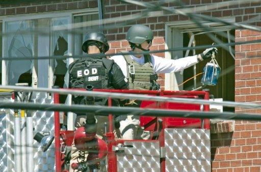 Explosives experts work outside the appartment of shooting suspect James Holmes on July 21, in Aurora, Colorado. Police said they had cleared all remaining threats from the booby-trapped apartment of the gunman accused of the Batman theater massacre that left 12 people dead in Colorado