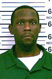 In this undated photo provided by the New York State Department of Correctional Services and Community Supervision, inmate Darrell Fuller is shown. New York City police arrested Fuller in the Queens borough of New York after a massive manhunt. Police say Fuiller shot and killed two men on a Long Island Highway, one of them a Nassau County Police Officer who had pulled his car over for leaving the scene of an accident. (AP Photo/New York State Department of Correctional Services and Community Supervision)