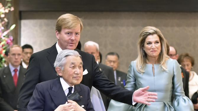 Japan's Emperor Akihito is escorted by King Willem-Alexander and Queen Maxima of Netherlands as he leaves a concert hosted by the King at a hotel in Tokyo