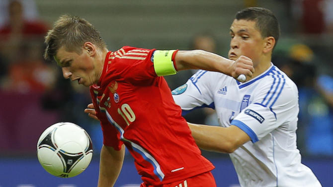 Russia's Andrei Arshavin, left, is challenged by Greece's Kyriakos Papadopoulos during the Euro 2012 soccer championship Group A  match between Greece and Russia in Warsaw, Poland, Saturday, June 16, 2012. (AP Photo/Sergey Ponomarev)