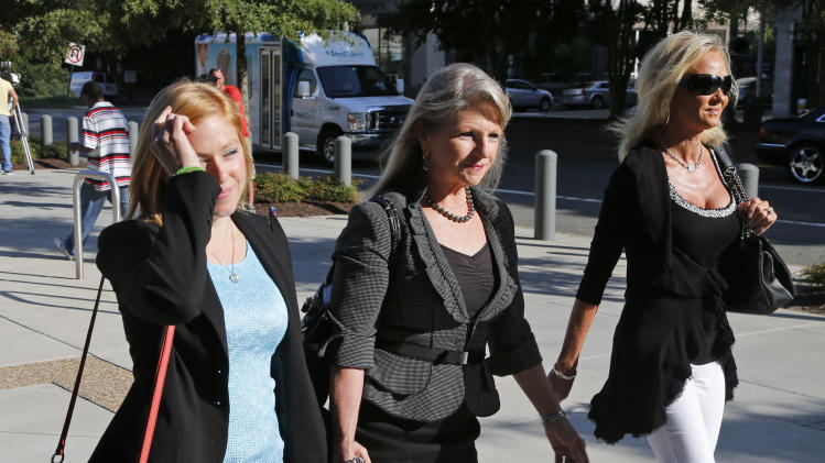Former Virginia first lady, Maureen McDonnell, center, arrives at federal court with her daughter Cailin Young, left, and friend April Niamtu, wife of Joe Niamtu, a cosmetic surgeon, Friday, Aug. 29, 2014, in Richmond, Va. Closing arguments are expected to begin Friday in the McDonnell's corruption case. (AP Photo/Steve Helber)