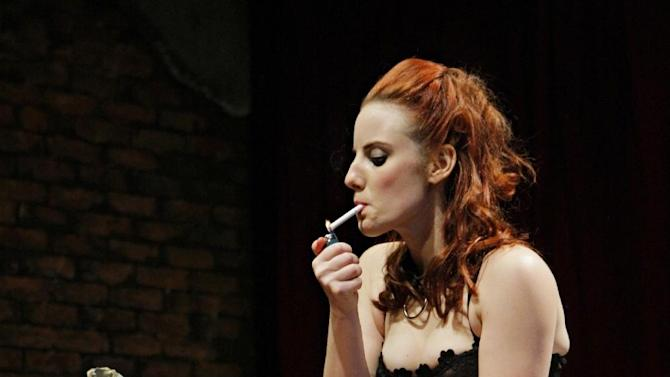 "In this Jan. 29, 2013 photo, Vanda, played by Anna Sundberg, smokes during a dress rehearsal for the play ""Venus in Fur"" at the Jungle Theater in Minneapolis, Minn. Minnesota lawmakers are trying to amend the state's smoking ban to eliminate an exemption for theatrical productions. (AP Photo/Michal Daniel)"