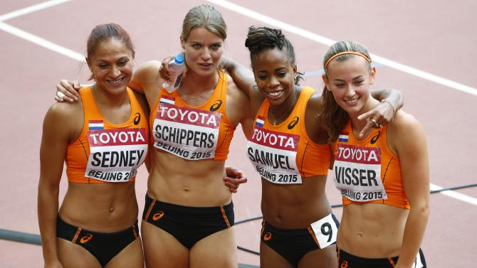 Netherlands poses after their women's 4 x 100 metres relay heat at the 15th IAAF Championships at the National Stadium in Beijing