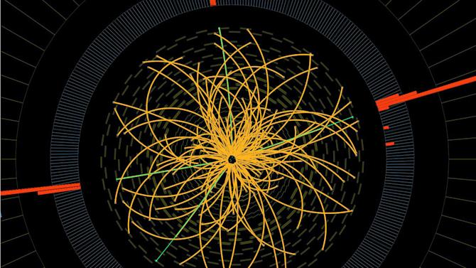 """FILE - This 2011 image provided by CERN, shows a real CMS proton-proton collision in which four high energy electrons (green lines and red towers) are observed in a 2011 event. The event shows characteristics expected from the decay of a Higgs boson but is also consistent with background Standard Model physics processes. Physicists say they are now confident they have discovered a long-sought subatomic particle known as a Higgs boson.  The European Organization for Nuclear Research, called CERN, says Thursday March 14, 2013  a look at all the data from 2012 shows that what they found last year was a version of what is popularly referred to as the """"God particle.""""   (AP Photo/CERN)"""