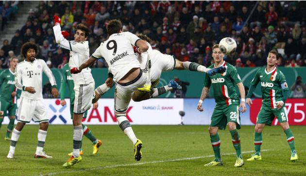 Bayern Munich's Mueller scores a goal against Augsburg during their third round German soccer cup (DFB-Pokal) match in Augsburg