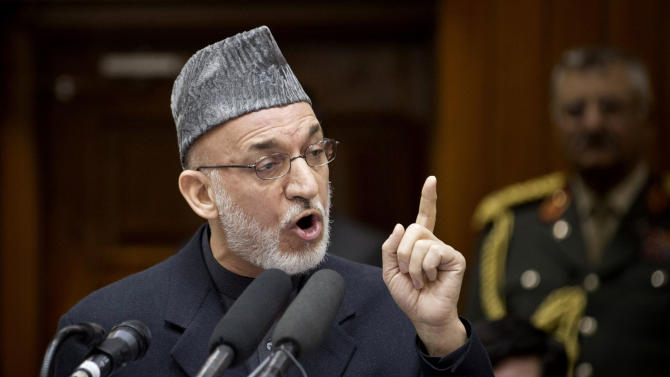 Afghan President Hamid Karzai addresses the Afghan Parliament in Kabul, Afghanistan, Wednesday, March 6, 2013. Karzai called on his security forces to end incidents of torture and abuse of the Afghan people, and said that Afghan forces are violating their own people's rights, making it harder for him to raise the issue when abuses are carried out by foreigners.  (AP Photo/Anja Niedringhaus)