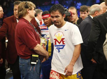 Pacquiao of the Philippines leaves the ring after losing to Mayweather, Jr. of the U.S. in their welterweight title fight in Las Vegas