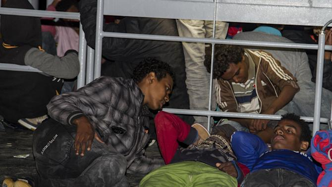 This picture taken late Tuesday, June 2, 2015, shows migrants in the harbor of the Italian southern island of Lampedusa. Some 234 migrants have been taken to Lampedusa after being rescued from the sea in the Sicilian Channel. (AP Photo/Mauro Buccarello)