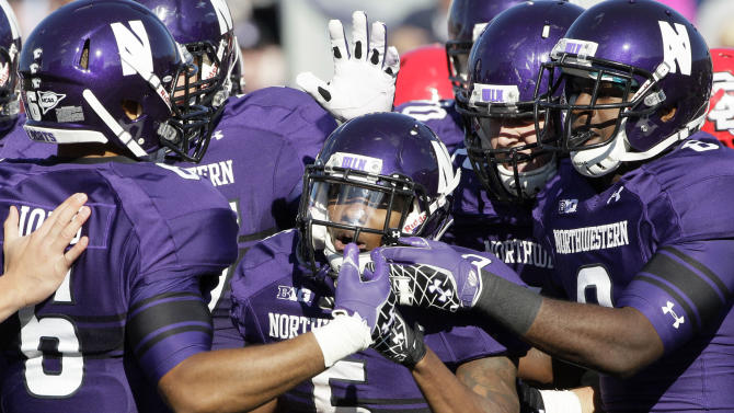 Northwestern running back Venric Mark (5) celebrates a touchdown with teammates during the first half of an NCAA college football game against South Dakota in Evanston, Ill., Saturday, Sept. 22, 2012. (AP Photo/Nam Y. Huh)