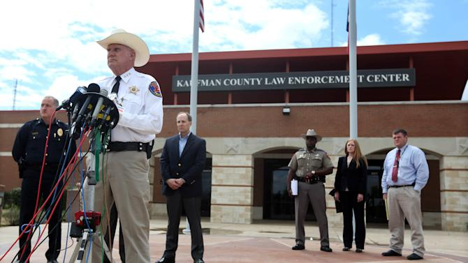 Kaufman County Sheriff David Byrnes, second from left, speaks at a news conference, Sunday, March 31, 2013, in Kaufman, Texas. On Saturday, Kaufman County District Attorney Mike McLelland and his wife, Cynthia, were murdered in their home. (AP Photo/Mike Fuentes)