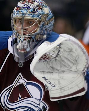 Colorado Avalanche goalie Semyon Varlamov, of Russia, searches for the puck while protecting the goal against the Dallas Stars in the third period of the Avalanche's 6-2 victory in an NHL hockey game in Denver on Monday, Dec. 16, 2013. (AP Photo/David Zalubowski)