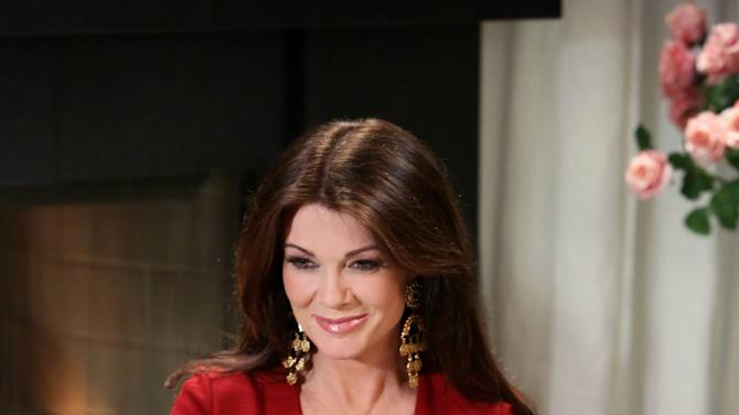 IMAGE DISTRIBUTED FOR I CAN'T BELIEVE IT'S NOT BUTTER! - In this image released on Monday, March 4, 2013, television personality, restaurateur and author Lisa Vanderpump serves Sugar-Glazed Buttery Cookies made with I Can't Believe It's Not Butter! while taping the 'Breakfast After Dark' webisode series in Los Angeles. The webisodes premiere March 25, 2013 at www.icantbelieveitsnotbutter.com. (Photo by Casey Rodgers/Invision for I Can't Believe It's Not Butter!/AP Images)